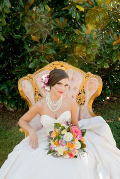 Southern Magnolia Bride in vintage pink and gold chair at Jubilee Hills in Lewisburg, TN. Lea-Ann Belter dress and florals by Lumberyard Gardens. Photo by Twila's Photography