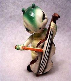 Caterpillar Figurine Playing Bass Musical Instrument