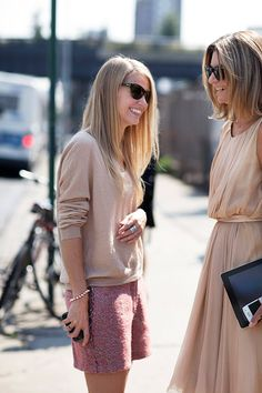 Neutral, natural colors--not sure they would be my choice, but they could have a different feel against a dark complexion. I'm more interested in the shape and the proportions of the outfit on the left. Kind of strikes me as sporty? But the soft colors definitely mitigate that. And the textures. The textures work in tandem with the colors.