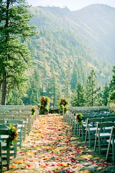 Leaves scattered across the aisle fit perfectly with this scenic fall wedding!