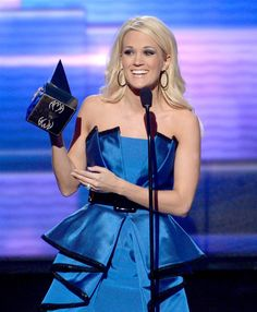 Carrie Underwood accepts the award for favorite country music album at the 2012 American Music Awards. (Photo: Kevin Winter / Getty Images)