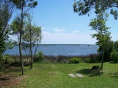 SOLD!!!  390 J Bell Ln, Newport, NC  SELLERS LOSS IS YOUR GAIN-BIG PRICE DROP FOR ONLY FOUR MORE WEEKS THEN ITS GONE BEST SOUNDFRONT VALUE ON MARKET OVER 1 ACRE DIRECT SOUNDFRONT SHADED BY A CANOPY OF BEAUTIFUL OLD OAK TREES-YOU CAN HEAR THE QUIET OVER 112 ON THE SOUND WITH VIEWS OF BOATS WILDLIFE and WEATHER. ALMOST 1900 SF 3 BRM2 BATH HOME CURRENTLY RENTED AS DUPLEX. USE NOW AS SUMMER HOME OR REMOVE. BUILD YOUR DREAM HOME. CROATAN SCHOOL DISTRICT-NO CITY TAX OR HOA DUES. VERY PRIVATE.