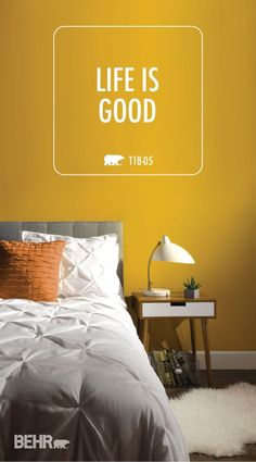 Brighten your day with BEHR Paint in Life Is Good from the BEHR 2018 Color Trends collection. This bright yellow color gives this bedroom a vibrant, happy style while neutral accents create balance. Use mid-century modern furniture to recreate the minimalist style of this room in your home.