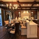 The kitchen on FrontDoor.com features a large center island with a breakfast banquet, charming coffered ceilings and high-end stainless steel appliances.   HGTV FrontDoor