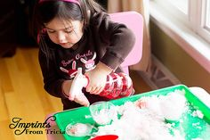 Coloring snow with spray bottles filled with water and food coloring!