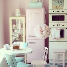 Who likes a Smeg refrigerator? Love how this pink Smeg fits a 60's style kitchen...