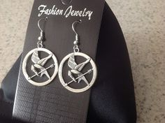 Here are some Mockingjay Drop earrings, make sure you look the part when you go to see the Mockingjay Part 2 movie.