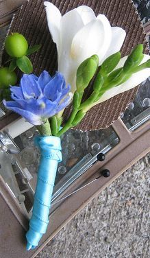With a dark royal blue flower and the white freesia... Blue wedding flowers