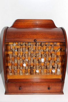 19th Century  Australian Cedar Apothecary Cabinet.  Roll down front, drawer in bottom, some bottles labelled Edgar S Wigg and Co., Homeopathic, Chemist 12 Rundle St, Adelaide, Australia.   via Carter's Price Guide to Antiques and Collectables. carters.com.au     suzilove.com