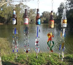 Our beer bottle wind chimes are 100% unique and hand made to order. Each chime is made from a recycled beer bottle that was personally hand cut and sanded to perfection. We then add 3 hanging sections of colored and textured glass and beads that match the beer bottle to create an amazing beer bottle wind chime sound. No 2 chimes will ever be the exact same!!! #etsy #beer #windchime #decor