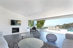 ALA VALTAMERI, Camps Bay Self Catering Accommodation Cape Town - Modern, luxurious and spacious 5 bedroom villa overlooking the ocean. All bedrooms en-suite, swimming pool, indoor/outdoor entertainment area with views of the Atlantice Ocean. Lush garden, security and free WiFi. Sleeps 10.