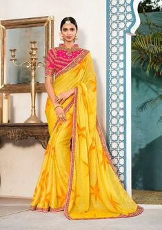 Yellow chiffon shaded sari paired with a fuchsia pink art silk unstitched blouse. This sari and blouse are beautified with zari and thread floral embroidery and stone work. This sari measures meter, including a meter blouse piece. Yellow Saree, Yellow Blouse, Chiffon Saree, Georgette Sarees, Party Wear Sarees Online, Casual Saree, Fancy Sarees, India Fashion, Latest Fashion