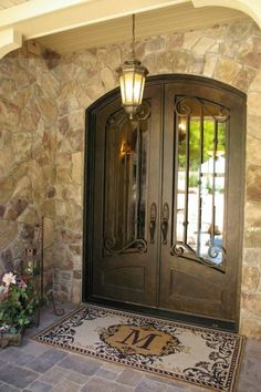 TUSCAN-STYLE FRONT DOORS - Tuscany barn front door with iron. We saw several homes that had Iron doors and fell in love with the idea Iron Front Door, Double Front Doors, Front Door Entrance, Front Door Mats, Door Entryway, Front Porch, Home Door Design, Front Door Design, Front Door Colors