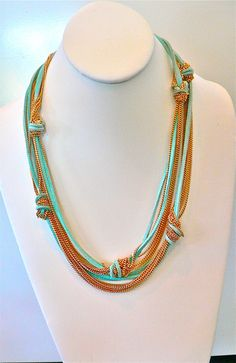 Sky blue suede and delicate gold chains combine for one great necklace!  Wear it long or doubled.