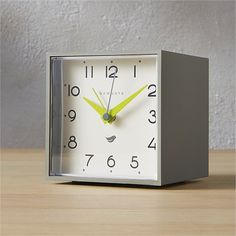 retro wakeup call. Grey-and-white alarm clock adds a wink of vintage charm to the nightstand or table. Bright green second hands tick tock with modern pop.