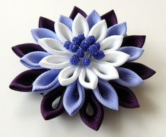 A flower is made in the technique of tsumami kanzashi. Alligator type hair clip . Flower is made from grosgrain ribbons. Flower`s diamater is ~ 2 1/2 inch