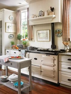 love the cream cabinets and black baseboard