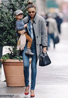 Working mother: The mother of one-year-old Flynn has regularly been seen stepping out with her pride and joy in New York City