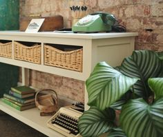 Farmhouse Ivory Console Table, white painted furniture, wicker drawers, rattan, house plants, green telephone. cream typewriter, hallway table, hallyway furniture