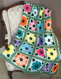 Would love to have an afghan like this!  (Crocheted afghan Flower Blocks by BernoullisAttic on Etsy)