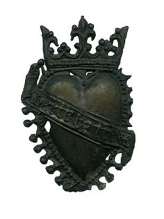 During the 14th and 15th centuries, the heart was the most common symbol of love. Heart brooches and pendants appear to have been universally popular. Over 50 medieval pewter heart badges have been found in London, most of these on the Thames foreshore. Many are crowned hearts, fringed with imitation pearls. Some, like this one, have a sash-like scroll with the lover's message 'herte be trew' ('heart be true'). This was probably a love-token, given to a loved one as a present.