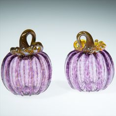 Purple glass pumpkin, This piece is one of our smaller pumpkins, they range in size from 3-4 inches. Some of the pumpkins we roll through a little frit on the surface, frit is small chips of glass that give the piece a little extra sparkle. This is a great fall wedding gift, Fall decor, gift for mom, gift for a friend, gift for dad, or just a nice little pumpkin to add to your collection. I make everything in Corning, NY #Glasspumpkin #purplepumpkin #falldecoration #giftformom… Small Pumpkins, Glass Pumpkins, Painted Pumpkins, Purple Art, Purple Glass, Pumpkin Wallpaper, Purple Pumpkin, Corning Museum Of Glass, Dragon Crafts