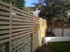 Larch Fence to raise height of a garden wall in Brighton Small Garden On A Budget, Small Garden Layout, Small Garden Fence, Small Backyard Patio, Backyard Fences, Small Garden Design, Garden Fencing, Wooden Garden, Glass Garden