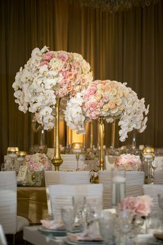 Lush Centerpieces on Gold Stands Photography: Jessica Claire Photography Read More: http://www.insideweddings.com/weddings/traditional-armenian-ceremony-luxurious-ballroom-reception/1006/