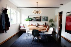 Classic Black Floors Beautifying Elegant Home Interiors : Modern Dining Room With Round Wooden Dining Table Under Pendant Lamp With White Di...