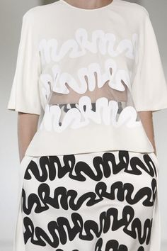 Graphic squiggle patterns, transparent fabric insert & relaxed silhouette; fashion design details // Issa Spring 2015