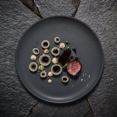 Aged beef, forest mushroom cream, smoked onions, and truffle by @vladelo #TheArtOfPlating