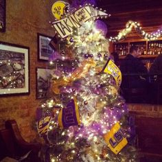 LSU Christmas Tree for Taylor's apartment. Have to do an OU one for Kayleigh. Christmas Tree Themes, Christmas Projects, Christmas Ornaments, Holiday Decor, Christmas Things, Louisiana Homes, Lsu Tigers, All Things Purple, Favorite Holiday