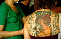 Alfons Mucha style tattoo, more on this site.