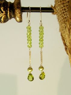 PERIDOT, VASUVIANITE, STERLING SILVER -- ONE-OF-A-KIND (F786) - Components: Peridot, vasuvianite, freshwater pearl and sterling petite shepherd hook style earwire (can be upgraded; see below).* ~ * ~ * ~ * ~ * ~ * ~ * ~ * ~ * If you wish to upgrade your earwire (14K, hypo-allergenic, leverback, etc), please view my Earwire Upgrade listings. Each Lisa Chandler piece of jewelry is an exclusive one-of-a-kind, intended to be as unique as the women who wear them! To inquire about a custom…