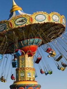 People Riding On Sea Swings At Santa Cruz Beach Boardwalk Amusement Parkby Sabrina Dalbesio