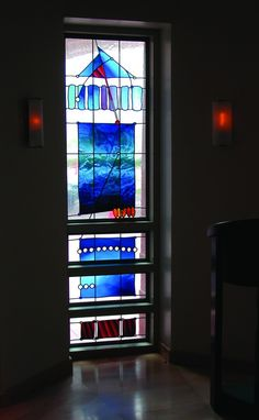 """""""Catherine of Siena Chapel"""" by Peter Mollica"""", 2000, Traditional stained glass techniques using hand-blown glass from Fremont Antique Glass Co., H 8′-6″ x W 2′-9″"""