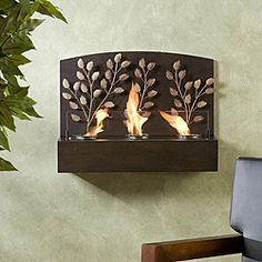 @Overstock.com - Vineyard Espresso Bronze Metal Wall Mount Fireplace - A modern and glorious addition to any wall, this antique wall mount fireplace features three flickering flames against a backdrop of metal leaves and espresso wood. Use gel fuel for these dancing flames or a pillar candle for a more natural look.  http://www.overstock.com/Home-Garden/Vineyard-Espresso-Bronze-Metal-Wall-Mount-Fireplace/4852349/product.html?CID=214117 $109.99