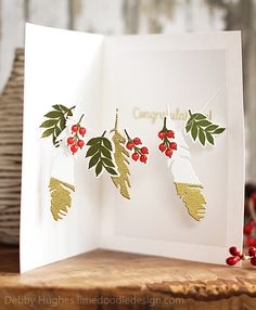 When the card is stood open the garland stretches out to display the elements