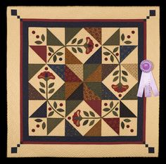 Honorable Mention, Category 6, Wall Quilts, Hand Quilted Any Type: Prairie Star Posies, Kathy Munkelwitz, Isle, Minn. wiquiltexpo.com