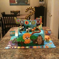 Happy birthday to my son Elijah. He's just as cute and wild as the animals on his cookies and cream cake.