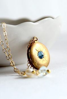 """Hokulani means """"heavenly star."""" Tiny golden locket necklace by Kahili Creations of Hawaii..."""