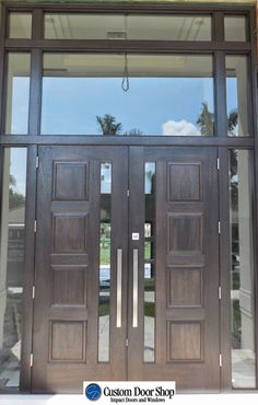 Large double front doors with sidelights and transom. Mahogany wood doors with … Large double front doors with sidelights and transom. Mahogany wood doors with four panel design and stainless steel pulls. Double Front Entry Doors, Wood Front Doors, Modern Front Door, Front Door Entrance, Glass Front Door, Patio Doors, Aluminium Front Door, Wood Exterior Door, Contemporary Doors