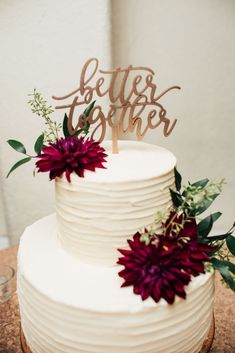 Simple 2-tier textured cake, burgundy dahlias, Better Together cake topper Cake: Alma Bakery, Alma, Kansas Cake Topper: NGO Creations Flowers: Kistner's Manhattan, Kansas Photo: Emma York Photography