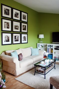love the wall color and how the frames are aligned on the wall