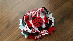 Check out this item in my Etsy shop https://www.etsy.com/listing/274439396/lady-bug-summertime-hairbow-polka-dot