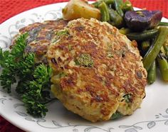 Salmon Patties. Delicious! My alterations: I used fresh salmon, dry parsley, Cajun seasoning, no pepper, no butter, and browned them in garlic olive oil. So good!