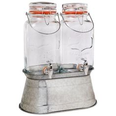 You can entertain in a fun and casual style with these 2 Del Sol jugs on a galvanized metal base from Home Essentials & Beyond. With a 1 gallon capacity each, it is perfect for numerous iced teas or cold drinks on a hot summer day. Mason Jar Party, Mason Jars, Thing 1, Drink Dispenser, Galvanized Metal, Kitchen Gadgets, Kitchen Tools, Kitchen Supplies, Kitchen Ideas