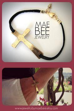 Sideways Cross in Gold Pewter on Black Leather bracelet from JewelryByMaeBee on Etsy.