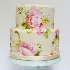 A wedding cake painted with edible food colouring to match the bride's bouquet.