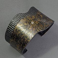 """Wolfgang Vaatz: , Cuff bracelet in argentium silver, 22k gold, and 3mm diamond. Bracelet is approximately 1"""" - 1.5"""" wide."""
